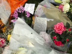 Floral tributes were placed for Mrs Powell and her children (Steve Parsons/PA)