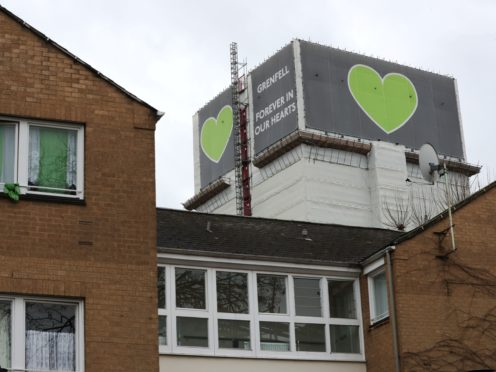 Grenfell Tower looms behind Blechynden House in Kingsdown Close (Jonathan Brady/PA)