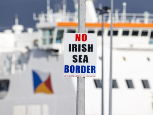 A sign on a lamp post outside Larne Port with the word 'No Irish Sea Border'.