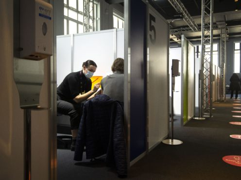 A man receives an injection of the Covid-19 vaccine at the Science Museum in London (Victoria Jones/PA)