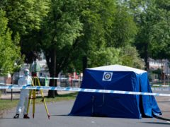 A forensics officer at the scene in College Road, Kingstanding, Birmingham (Jacob King/PA)