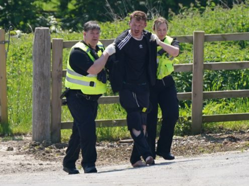 A man is detained at Hallington House Farm, on the outskirts of Louth, Lincolnshire (Joe Giddens/PA)