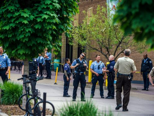 Police officers investigate a fatality in an officer involved shooting (Richard Tsong-Taatarii/AP)