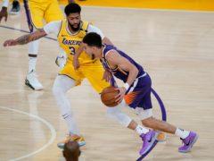 Los Angeles Lakers forward Anthony Davis defends against Phoenix Suns guard Devin Booker (Ashley Landis/AP)