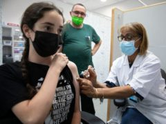 Israel is sending one million doses of the Covid vaccine to the Palestinians (Sebastian Scheiner/AP)