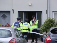 Gardai at the property in Clashmore, Co Waterford (Niall Carson/PA)