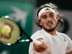 Stefanos Tsitsipas slams a forehand during his French Open quarter-final win over Russia's Daniil Medvedev (Thibault Camus/AP)