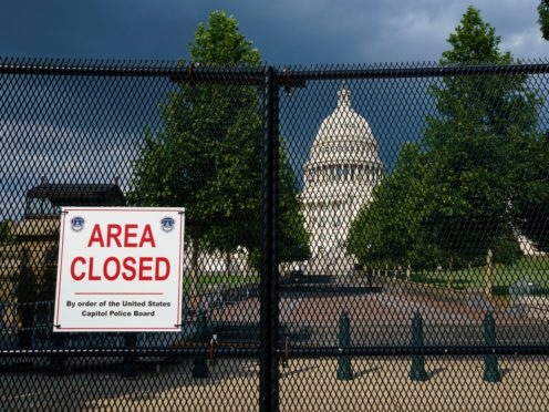 The US Capitol, still surrounded by perimeter fencing almost six months after the insurrection in which supporters of Donald Trump stormed the building ((J Scott Applewhite/AP)