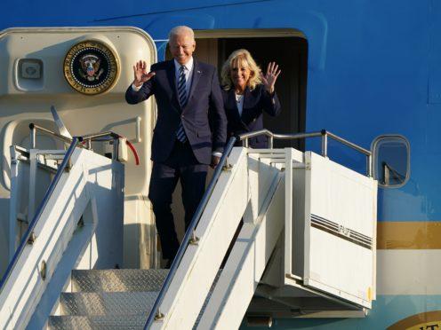 US President Joe Biden and First Lady Jill Biden arrive on Air Force One at RAF Mildenhall (Joe Giddens/PA)