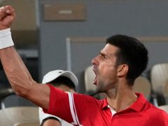 Novak Djokovic roared towards his support camp at the end of the match (Michel Euler/AP)