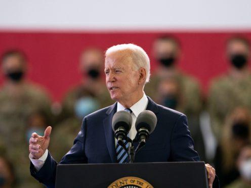 US President Joe Biden addresses US military personnel at RAF Mildenhall in Suffolk (Joe Giddens/PA)