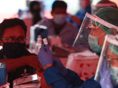 Health workers prepare doses of the AstraZeneca vaccine in Jakarta (Achmad Ibrahim/AP)