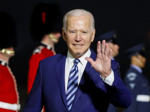 US President Joe Biden waves on arrival on Air Force One at Cornwall Airport Newquay ahead of the G7 summit (Phil Noble/PA)