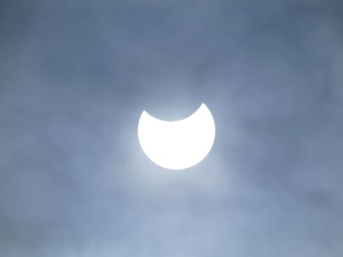 A partial solar eclipse as seen over Liverpool (Peter Byrne/PA)