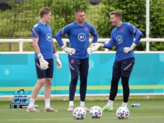 Jordan Pickford (left) is facing competition from Dean Henderson and Sam Johnstone to start for England (Nick Potts/PA)