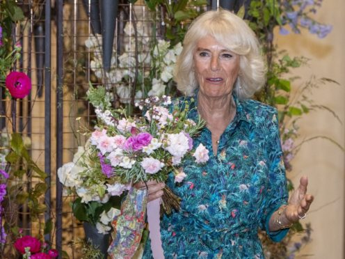 The Duchess of Cornwall was presented with a bouquet containing rosemary, a sign of remembrance, on what would have been the Duke of Edinburgh's 100th birthday (Geoff Pugh/Daily Telegraph/PA)