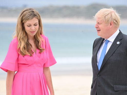 Prime Minister Boris Johnson and Carrie Johnson arrive for the leaders' official welcome and family photo during the G7 summit in Cornwall (Leon Neal/PA)