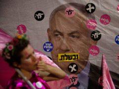 A protester demonstrates against Israeli Prime Minister Benjamin Netanyahu outside his official residence in Jerusalem (Ariel Schalit/AP)