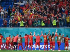 Belgium's players celebrate with their fans after a 3-0 win over Russia (Kirill Kudryavtsev/AP/PA)