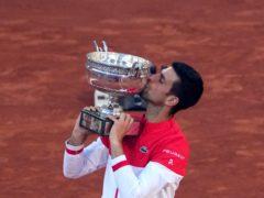 Novak Djokovic kisses the Coupe des Mousquetaires after his victory in Paris (Christophe Ena/AP)