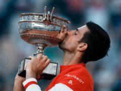 Novak Djokovic kisses the Coupe des Mousquetaires (Thibault Camus/AP)