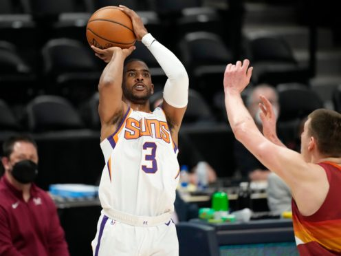 Chris Paul, centre, and Devin Booker showed off their NBA Championship credentials – combining for 71 points as the Phoenix Suns booked a spot in the Western Conference finals (David Zalubowski/AP)