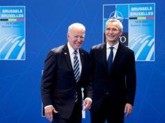 US President Joe Biden is welcomed by Nato secretary general Jens Stoltenberg (AP/Francois Mori, Pool)