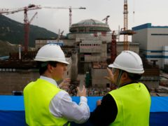 The then Chancellor of the Exchequer George Osborne on a trip to the nuclear plant in 2017 (Bobby Yip/AP)