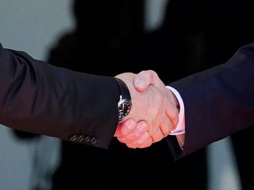 President Joe Biden, right, shakes hands and meets with Russian President Vladimir Putin (Patrick Semansky/AP)