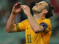 Gareth Bale reacts to his penalty miss against Turkey (Tolga Bozoglu/AP)