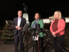 Mary Lou McDonald speaks to reporters in the early hours of Thursday flanked by party colleagues Michelle O'Neill and Conor Murphy (David Young/PA)