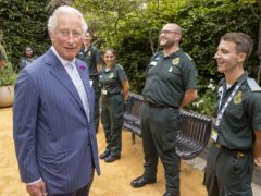 Prince Charles meeting NHS staff during a visit to Chelsea and Westminster Hospital (Steve Reigate/Daily Express/PA)