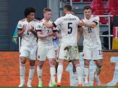 Kevin De Bruyne (second left) celebrates after firing Belgium to victory over Denmark (Martin Meissner/AP/PA)