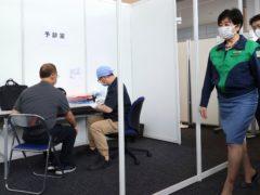 Tokyo Governor Yuriko Koike, visits a vaccination centre ((Yoshikazu Tsuno/Pool Photo via AP)