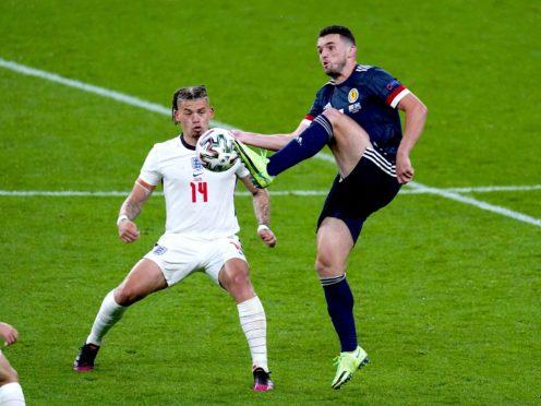 John McGinn competes with England's Kalvin Phillips (Mike Egerton/PA)