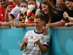 Germany's Joshua Kimmich celebrates after the win over Portugal (Christof Stache/AP)