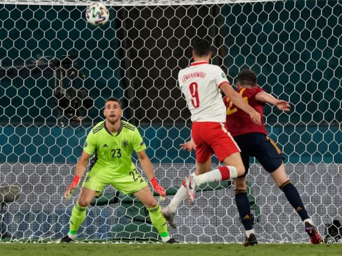 A towering header from Robert Lewandowski (centre) helped Poland come back to draw against Spain in Seville (Thanassis Stavrakis/AP)