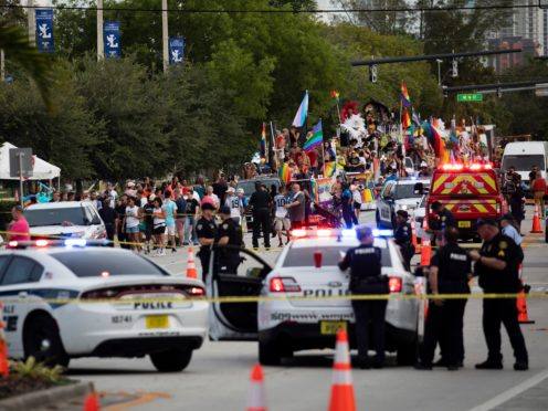 Police and firefighters respond after a truck drove into a crowd of people injuring them during The Stonewall Pride Parade and Street Festival in Wilton Manors (Chris Day/South Florida Sun-Sentinel/AP)