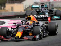 Max Verstappen passed Lewis Hamilton to take the win (AP Photo/Francois Mori)