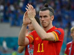 Gareth Bale applauds fans after Wales qualified for the last 16 of Euro 2020 (Riccardo Antimiani/AP)