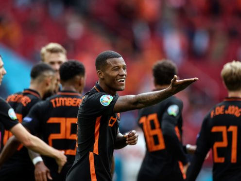 Georginio Wijnaldum celebrates after scoring Holland's second goal against North Macedonia (Kenzo Tribouillard/AP/PA)