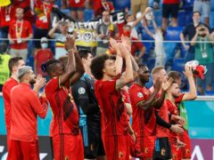 Belgium players celebrate their victory over Finland (Anatoly Maltsev/AP).