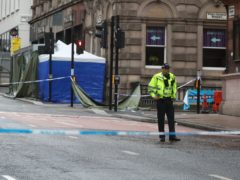 Police at the scene of the Park Inn Hotel stabbings (Andrew Milligan/PA)