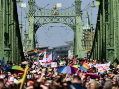 People march across the Szabadsag, or Freedom Bridge over the River Danube (AP)