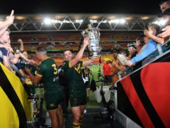 Handout photo provided by NRL Imagery of Australia's Cameron Smith poses with the trophy after the final of the 2017 Rugby League World Cup at the Suncorp Stadium, Brisbane .