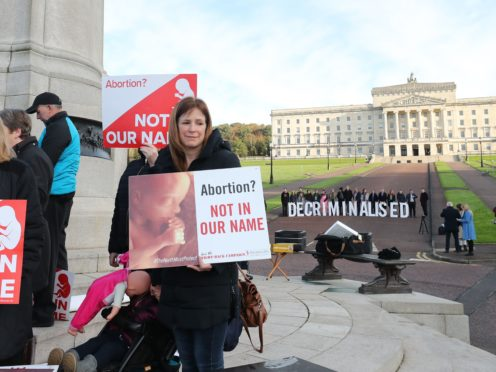 Anti-abortion and pro-choice activists take part in separate protests at Stormont (Niall Carson/PA)