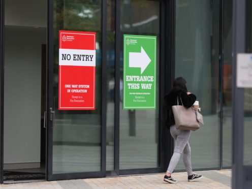 Signs on a window at Manchester Metropolitan University (PA)