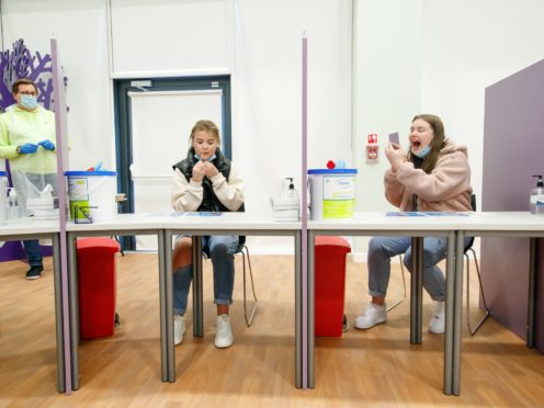 Students Ellie Fisher (left) and Beth Hicks (right) take Coronavirus lateral flow tests at Outwood Academy Adwick in Doncaster (PA)