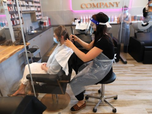 Juliette Menown gets her hair cut by stylist Sophie Alexandra at Natural Hair Company in Lisburn (PA)