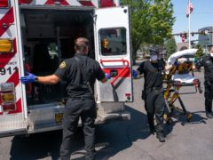 Salem Fire Department paramedics and employees of Falck Northwest ambulances respond to a heat exposure call during a heat wave in Salem, Oregon (AP)